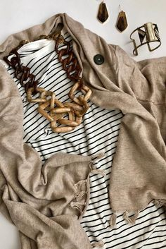Give us all the cozy layers + artisan made accessories #noondaystyle ( @mrsgoodnightgoesglobal)