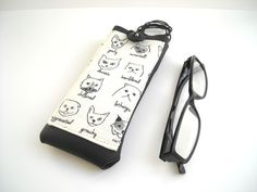 Funny cats glasses case, eyeglass neck holder, eyewear cover with lanyard, black and white eco leather vegan sunglasses case with pocket by Lunica on Etsy https://www.etsy.com/listing/495559949/funny-cats-glasses-case-eyeglass-neck