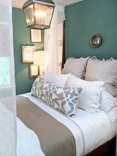 Neutral bedding tones and teal walls. Love the lighting fixture. Love everything about this bedroom except not the white bedspread, I have dogs!