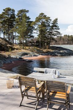 Picnic table by the lake. Summer on the island in Finland.
