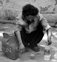 A beggar alone the street....