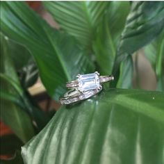 2.4ct Simple Baguette Engagement Set (2pc) Lead free alloy (brass) with rhodium plating for a platinum finish.  This piece is adorned with brilliant baguette shaped cubic zirconia stones and has the most unique design to ever hit wedding sets. Ocean Jewelers Jewelry