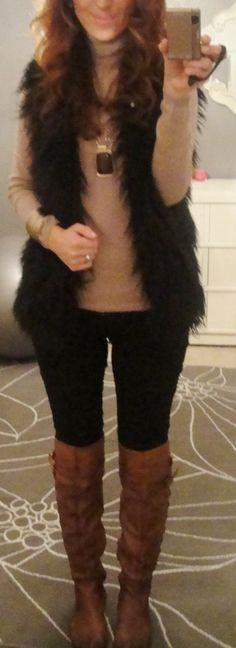Faux fur vest, black pants, brown boots