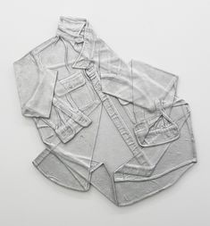 A.K. Burns, Shirt Discard (work shirt) 2013-2014 A series of wall hung mono-print reliefs cast in aluminum of my discarded work shirts after a day at the foundry. In a conflation between (my) creative labor and (the larger sphere of) maual labor, these are indexes haunted by absence—marking the economic and cultural shifts away from industrial labor towards immaterial and affective labor.