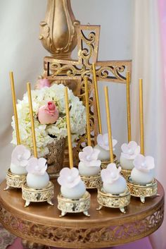 Flower cake pops at a pink and gold baptism party! See more party ideas at CatchMyParty.com!