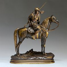 A fine Patinated and Signed Alfred Dubucand Bronze Sculpture with gilt highlights