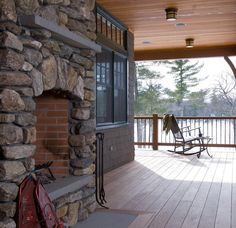 Outdoor fireplace in a Maine lake home.