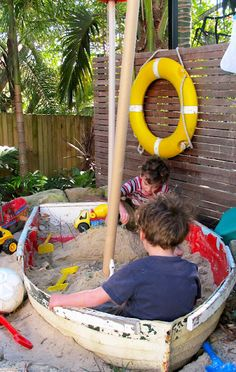 Beach Away From Home: 8 Cool Sandboxes That InspirePlay I love the one with the little play house attached.
