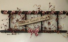 Primitive wooden ladder decorated with a wooden sign and berries - what a perfect match!  Each ladder is 24 long and 8 tall. Decorated with