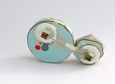 'Out with the old brooch' back by Vanessa Arthur.  Reclaimed wood, paint, laminate, copper, brass, 925 silver, stainless steel pin