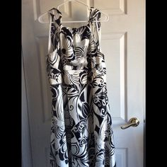 Ann Taylor Black & White Swing Dress Fully lined, knee length dress great for a graduation, wedding or wine tasting! Polyester. Ann Taylor Dresses