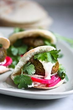An Authentic recipe for the BEST falafels ever, with instructions on how make the pita bread from scratch, the falafel sauce and the pickled turnips!   www.feastingathome.com