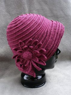 Beautiful cloche hat with flower. Has directions, but hard to understand. http://make-handmade.com/2011/06/13/pink-hat/