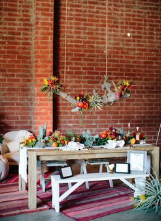 Found Vintage Rentals gavin farm table, mixed vintage seating and our anita manta rugs