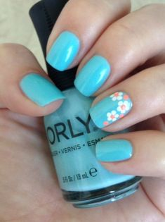 Nails • Orly Pretty-Ugly with white and Flip Flop Fantasy flowers. Pic does not do justice to these colors. Gorgeous aqua (new fav) and orange sherbet neon. #springnails