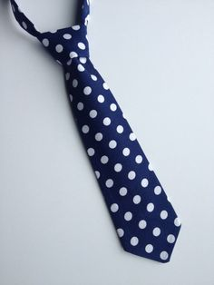A personal favorite from my Etsy shop https://www.etsy.com/listing/235568427/boys-neck-tie-navy-blue-and-white-polka