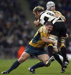 Schalk Burger feels the crunch as Matt Dunning goes in for a tackle