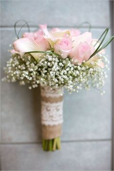 Pink roses and baby's breath bouquet.