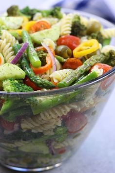 Springtime Pasta Salad recipe is light & savory. Perfect make ahead meal for company or potluck. Has simple lemon vinaigrette, olives and fresh veggies.
