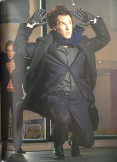 SHERLOCK (BBC) ~ Season 3, Episode 3: His Last Vow. Outside Magnussen's home, Sherlock (Benedict Cumberbatch) puts his hands up after he shoots as the helicopter arrives. [Photo from SHERLOCK CHRONICLES (2014), the SHERLOCK series official companion book.]