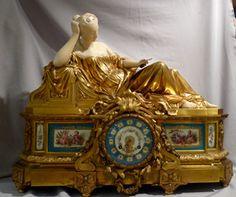Antique French ormolu, carrera marble and porcelain mantel clock signed Raingo Freres.
