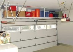 take advantage of the great space above in the garage with a hanging loft.  #organize #garage