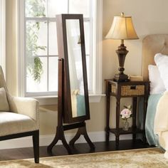 Who knew that inside the #mirror is a secret jewelry armoire? #multipurpose #kirklands #eCatalog