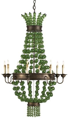 And a goddess she is! Green Godess Chandelier measures30rd x 49h and features eight lights. Draped orbs of green glass balls make this classic design something special. The wrought iron frame and wooden components are finished with Cupertino. The zing of the green glass makes it a standout in any beach-inspired setting. Material: Wrought Iron/Wood/GlassMaximum Wattage: 60 per bulb