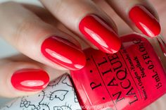 opi-hello-kitty 5 Apples Tall is a warm toned red nail polish with creme finish.