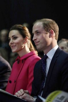 Prince William, Duke of Cambridge, and Catherine, the Duchess of Cambridge, attend a show as they visit The Door on December 9, 2014 in New York. The Door provides services to disadvantaged young people.