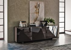 The Kayak 2 door sideboard in Polished Glossy Black, White, Moka, Red or Matt Graphite Wood. The Kayak features clear glass internal shelves and feet in stainless steel, matt white or graphite.