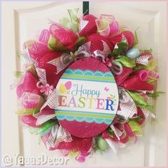 Happy Easter Wreath Wreath is made from rolled pastel colored mesh. Has 2 Easter ribbons and glitter eggs around. Happy Easter sign in the center with purple foil lettering. Great way to decorate your door at home, work, office, classroom, or gift it to someone. 24inch Approx Follow Us On Social Media: Facebook https://m.facebook.com/YaaasDecor/  Instagram: @Yaaasdecor