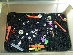 Magnets, metal & black beans?  This week our sensory table features black beans. I love the black color of the beans and how they make the colors of the other objects inside pop