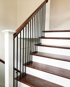Transitional Wood and Iron Stair Railing - Entry Renovation to Home Bannister Ideas, Wood Railings For Stairs, Indoor Railing, Loft Railing, Stair Railing Design, Staircase Remodel, Staircase Railings, Iron Spindle Staircase, Rod Iron Railing