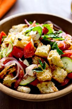 NYT Cooking: At the height of tomato season, for every perfectly ripe, taut and juicy specimen, there's an overripe, oozing counterpart not far away. The Tuscan bread salad called panzanella is the perfect place to use those sad, soft tomatoes that are still rich in flavor. Traditional panzanella is made with stale, dried bread that's rehydrated from a dressing of sweet tomato juices, vinegar and plenty of olive oil. This version also includes some mozzarella for richness and cucumber for…