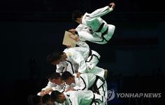 North Korean taekwondo demonstrators from the International Taekwondo Federation (ITF) perform during the opening ceremony of the World Taekwondo Federation (WTF) World Taekwondo Championships at T1 Arena in Muju, North Jeolla Province, on June 24, 2017.