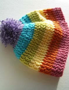 Rainbow stripe crochet hat with pompom.