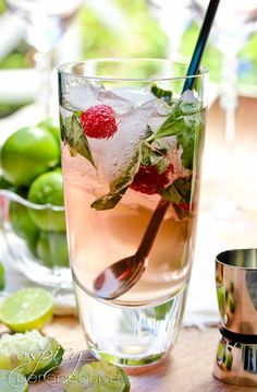 Fresh Basil Raspberry Mojitos-This vibrant Raspberry Mojito with Basil makes a Pitcher of Mojitos that is sure to be the life of the party! It's the best mojito recipe I've tasted, by far.