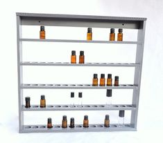 Displayyourshelf makes custom essential oil shelving made to hang on the wall. Also shelving for nail polish, golf balls, eliquids and more.