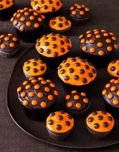 I wonder if Johnny and Dennis would help me decorate these ADORABLE black and orange chocolate cupcakes?