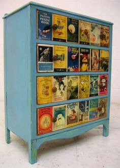 Painted chest of drawers with drawer fronts decoupaged with colorful book jacket fronts