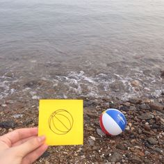 Two beach balls #postitdoodle #postit #doodle #beach #sea #westsea #balls #ball #yellow #memo #drawing #doodle #daily