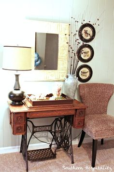 we have this exact vintage singer sewing machine table. this is a good idea for repurposing it into a decorative piece!!