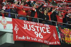 Liverpool fans display a banner relating to the Hillsborough disaster-1338835 615×410 pixels