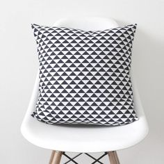 Are you interested in our geometric navy cushion cover? With our navy cushion cover triangles you need look no further.