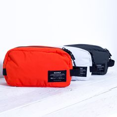 Wash Bag made with recycled materials. Fabric obtained in a 100% using recycled polyester from used plastic bottles. The fabric used is totally, water repellent, waterproof and breatheable. It is composed by 2 different layes of fabric.