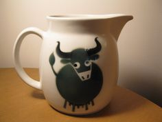 This Arabia pitcher was designed by Kaj Franck and decorated by Anja Juurikkala for Arabia Wartsila and part of the Heluna series. It bears the Arabia mark dating from *sold Cow, Tableware, Green, Design, Dinnerware, Tablewares, Cattle, Dishes