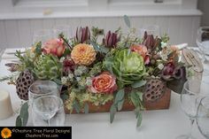 !danziger-10-crabtrees-kittle-house-wedding-flower-table-centerpiece-long-rectangular-wood-box-natural-rustic-loose-artichokes-kale-lotus-pods-astrancia