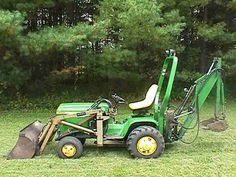JD 400 lawn tractor with attachments