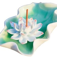 Slightly larger than your hand, 11.5 cm (4.5 inch).  It is the Lotus flower on its leaf. It can be used for cone, stick or corn incense. The hole for the incense stick is about 4 mm (0.15 inch).